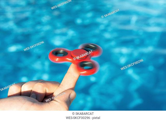 Finger balancing a fidget spinner
