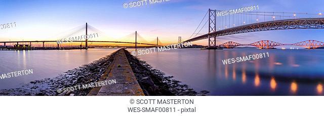 UK, Scotland, Fife, Edinburgh, Firth of Forth estuary, Panorama view from South Queensferry of Forth Bridge, Forth Road Bridge and Queensferry Crossing Bridge...