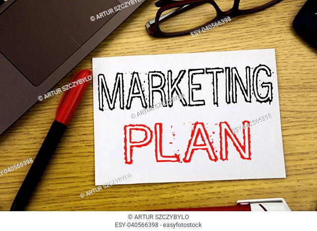 Handwriting Announcement text showing Marketing Plan. Business concept for Planning Successful Strategy written on paper, wooden background in office copy space