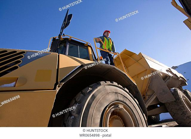 Engineer on an earth mover at a construction site