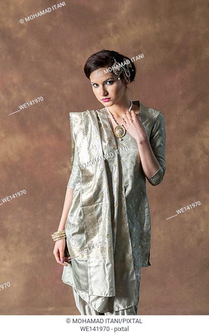 Beautiful Asian woman wearing shelwar kameez