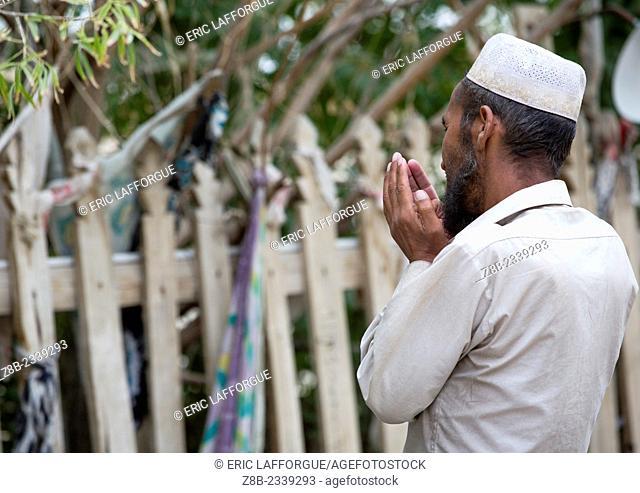 Man Praying At Imam Asim Tomb In The Taklamakan Desert, Xinjiang Uyghur Autonomous Region, China