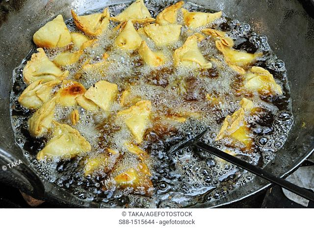 Cooking Samosa at the little shop by the street