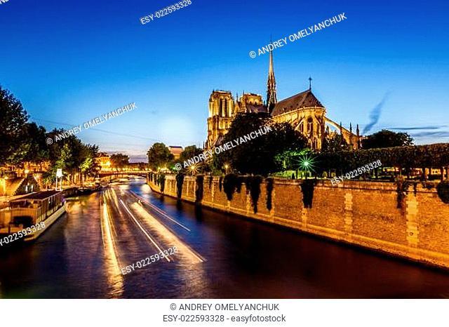 Notre Dame de Paris Cathedral and Boat Lights Trails on Seine River, Paris, France