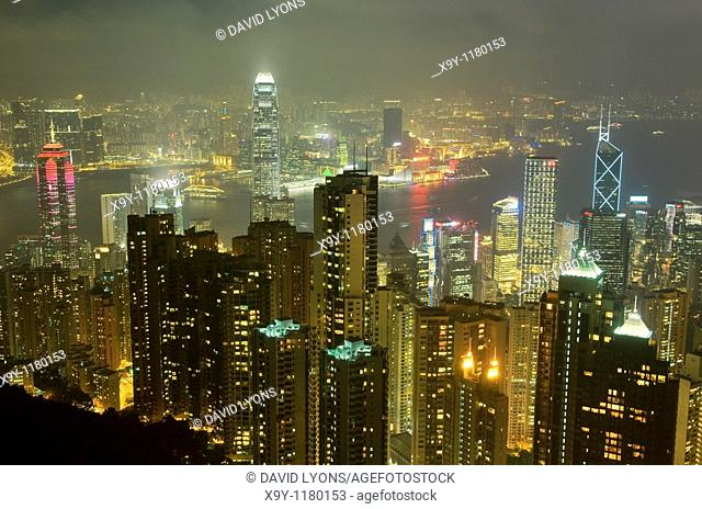 Hong Kong Island  Evening night view from Victoria Peak over city centre skyscrapers and Hong Kong Harbour to Kowloon shore