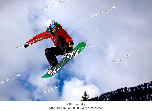 A snowboarder jumping at Red Mountain, Rossland, British Colombia, Canada, model released