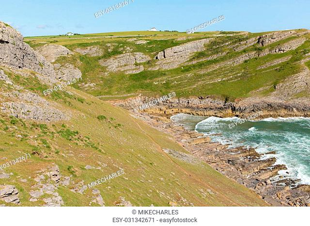 Mewslade Bay The Gower peninsula south coast near Swansea South Wales UK near to Rhossili beach and Fall Bay view out to sea with tide in