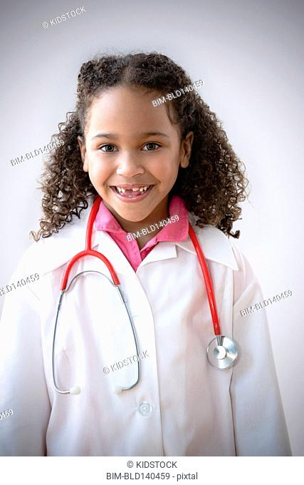 Mixed race girl playing doctor