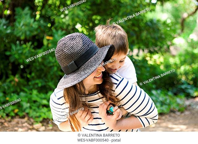 Playful mother and son outdoors