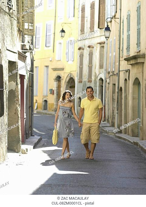 Couple walking down street in provence