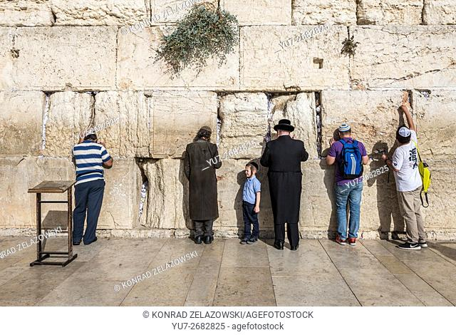 People praying at Western Wall (also called Kotel or Wailing Wall) in Jewish Quarter of Old Town of Jerusalem, Israel