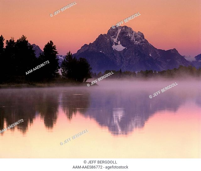 Mount Moran reflected in the Snake River with pink sunrise Grand Teton NP WY in Sept