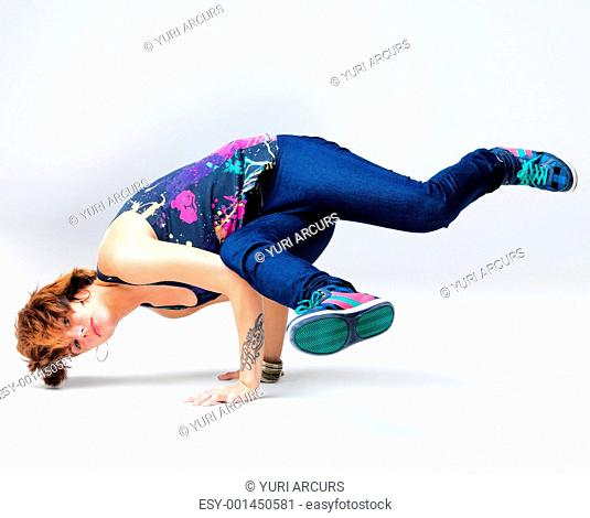 Portrait of a beautiful young female breakdancer doing freeze position - Copyspace