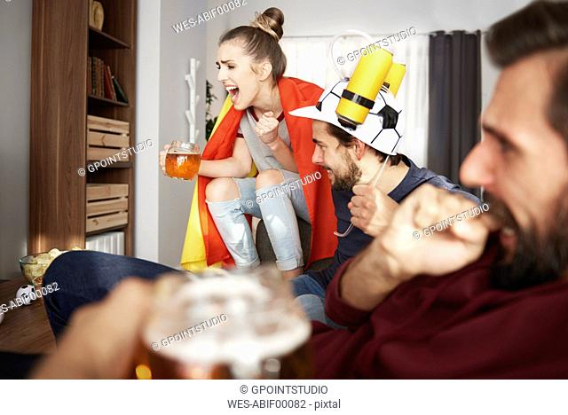 Excited football fans watching Tv
