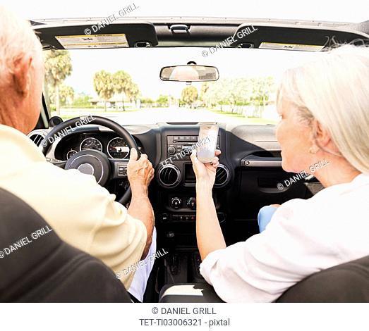 Senior couple in convertible car