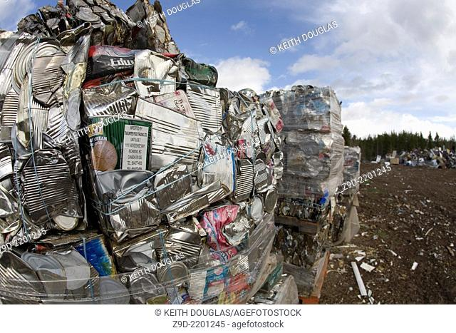 Pallets of crushed aluminum cans at recycling center, Smithers, BC