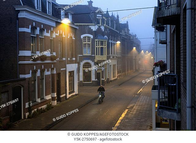 Tilburg, Netherlands. A foggy Tuinstraat, early morning just after sunrise
