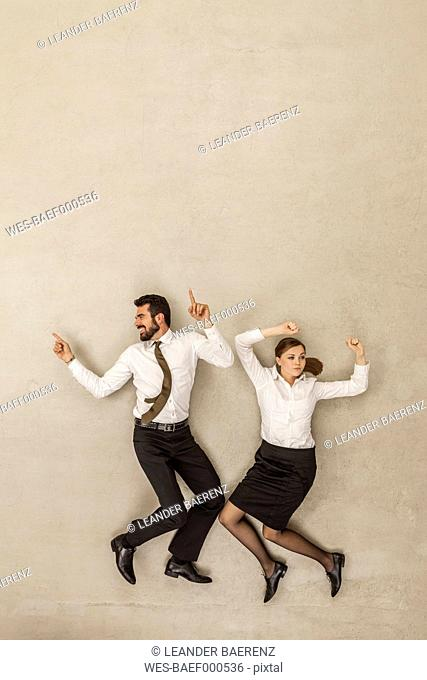 Business people dancing against beige background