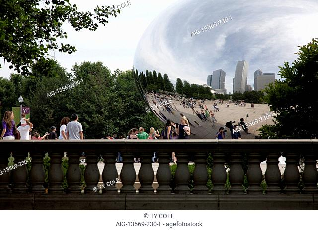 People reflected in convex mirrored sculpture Cloud Gate by Anish Kapoor, Chicago, Illinois