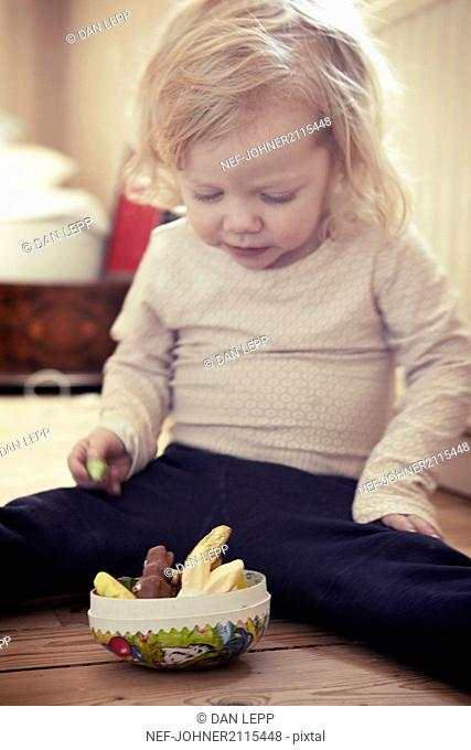 Toddler girl having a snack