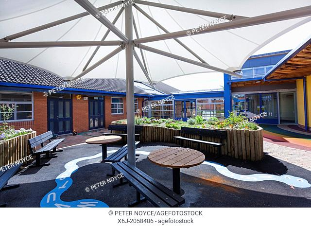 large umbrella style canopy to school garden play area