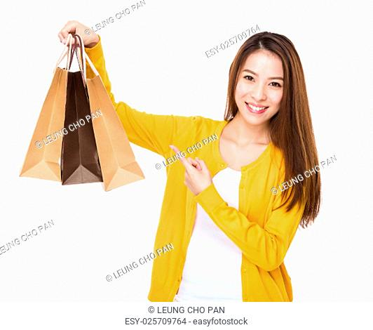Young woman finger point to shopping bag