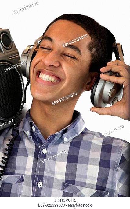 Boy listening to music on his headphones
