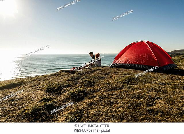 Young couple camping at seaside