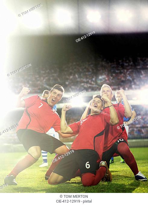 Soccer team celebrating on field