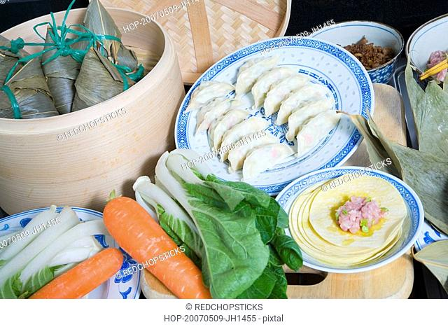 Close-up of Chinese dumplings with carrots and bok choys