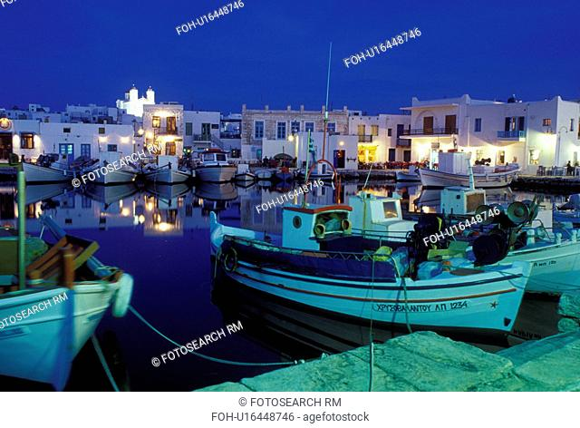 Paros, Greek Islands, Naoussa, Cyclades, Greece, Europe, Fishing boats docked in Naoussa Harbor in the evening on Paros Island on the Aegean Sea