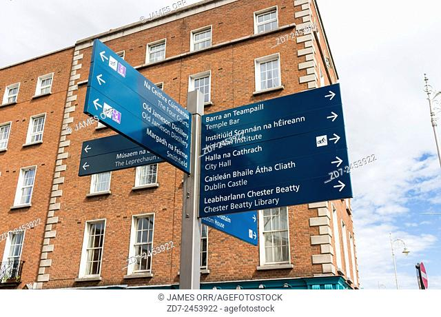 Dublin sign giving directions in English and Irish to places of interest.  Shooting Date 14/04/2015
