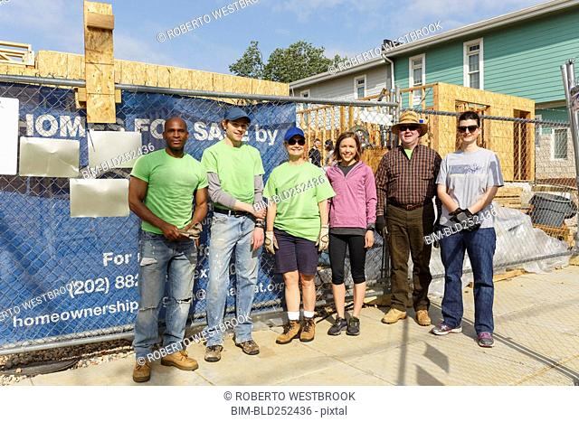 Portrait of volunteers at a construction site