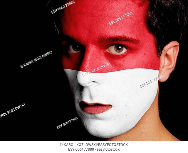 Flag of Monaco Painted on a Face of a Young Man