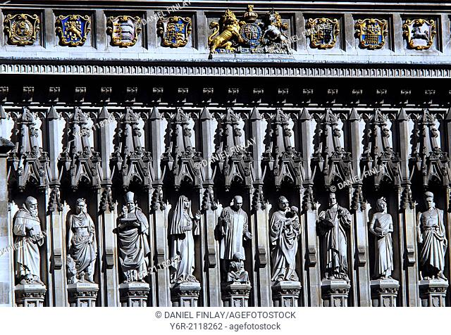 Frieze above the west entrance to Westminster Abbey in London, England. Though mediaeval looking, it actually features 20th century Christian martyrs - both...