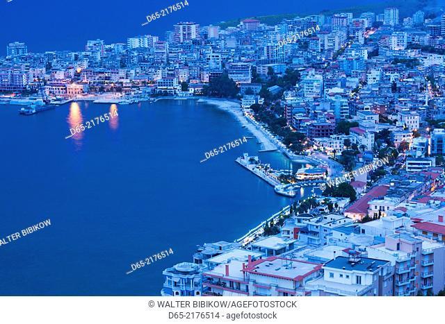 Albania, Albanian Riviera, Saranda, elevated city view, dusk