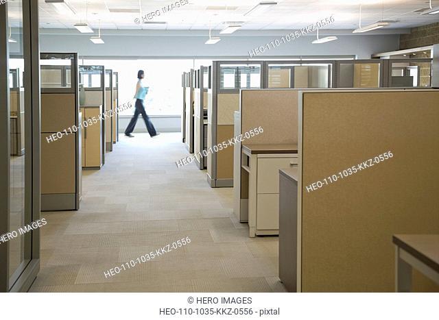 Businesswoman walking in office building