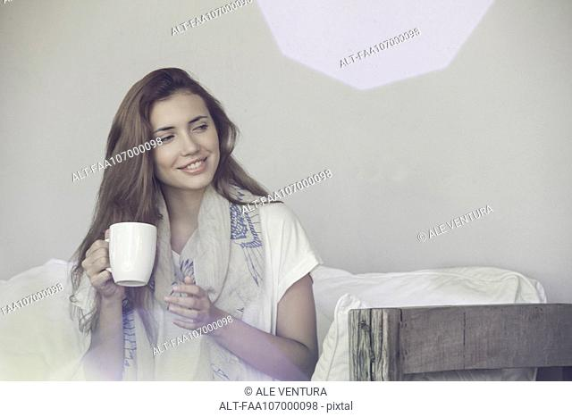 Woman enjoying solitude with cup of tea