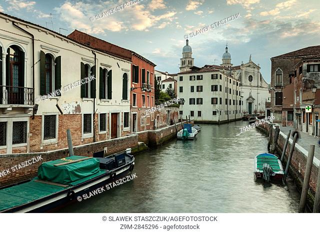 Evening in the sestier of Dorsoduro, Venice, Italy. Santa Angelo Raffaele church in the distance