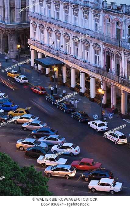 Cuba, Havana, Havana Vieja, traffic overview by the Parque Central, dusk