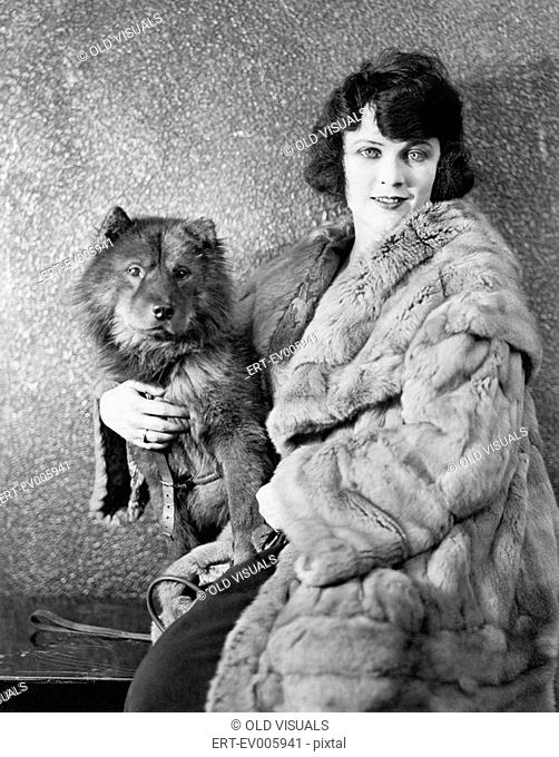 Woman in her fur coat sitting with her dog All persons depicted are not longer living and no estate exists Supplier warranties that there will be no model...