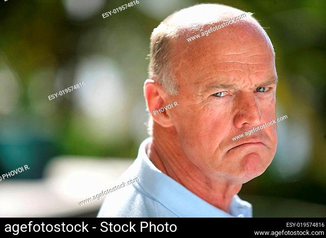 Portrait of a senior man upset with the air