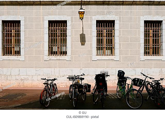 Row of bicycles parked outside building, Annecy, Auvergne-Rhone-Alpes, France