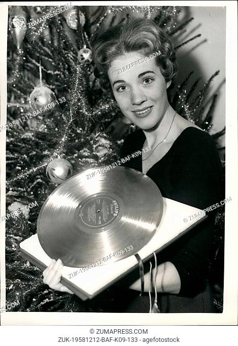 Dec. 12, 1958 - Julie Andrews With her 'Golden Disch'. Julie Andrews star of 'My Fair Lady' last evening received a 'Golden Disc' during the BBC TV programme...
