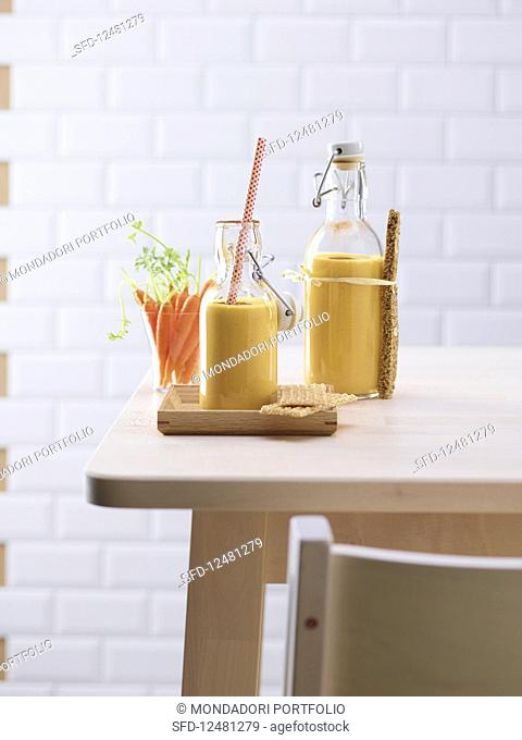 Carrot and mango smoothie with walnuts served with sesame seed brittle