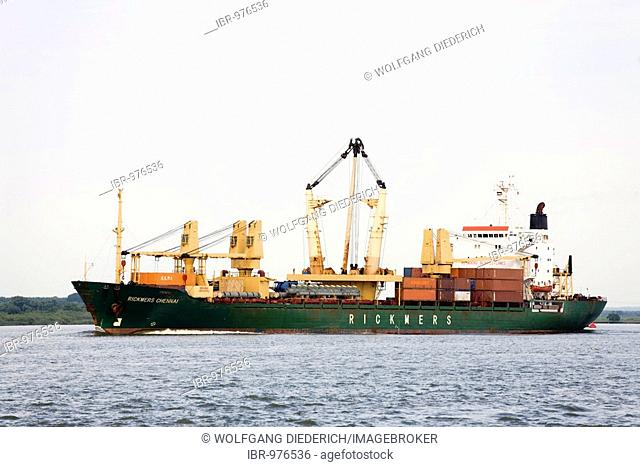 The Rickmers Chennai of the Rickmers line, a multi-purpose and heavy goods freighter, travelling down the Elbe River at Stadersand/Elbe in the direction of the...