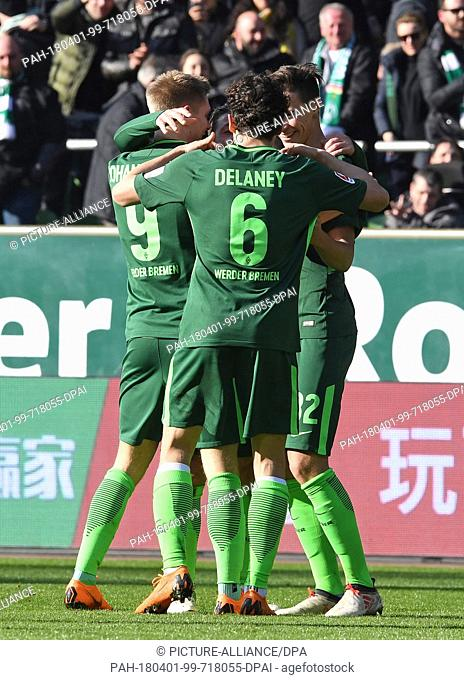01 April 2018, Germany, Bremen: soccer: Bundesliga, Werder Bremen vs Eintracht Frankfurt, in the Weser stadium. Werder's Zlatko Junuzovic (covered) celebrates...