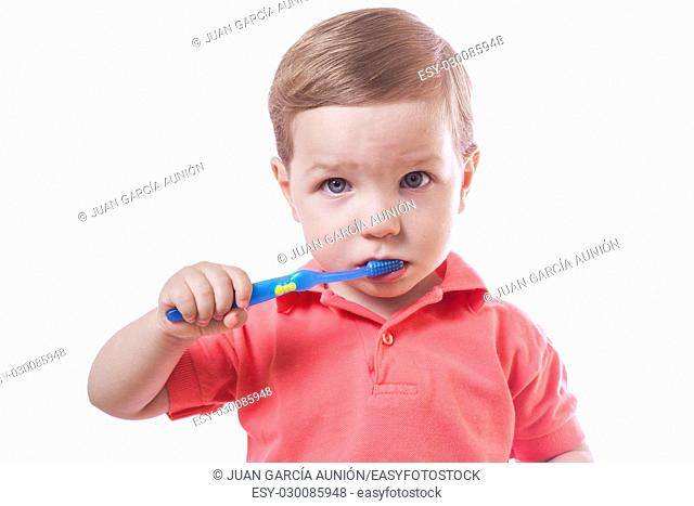Cute baby boy brushing teeth. Isolated over white background
