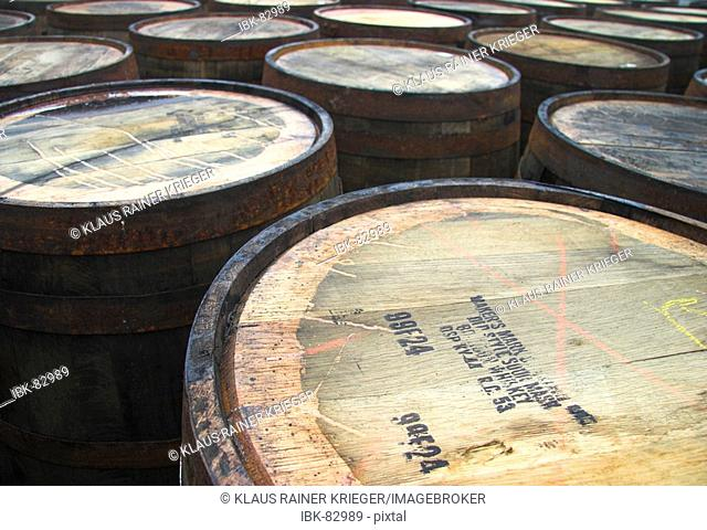 Used casks laying in the yard of a distillery, get recycled and filled again
