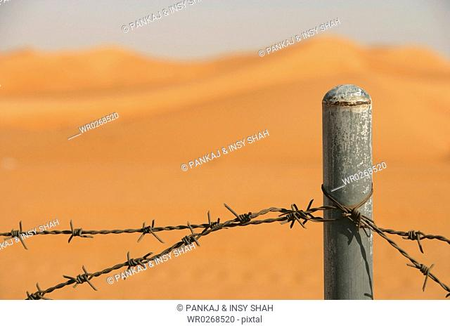 Security barb wire fence in the desert
